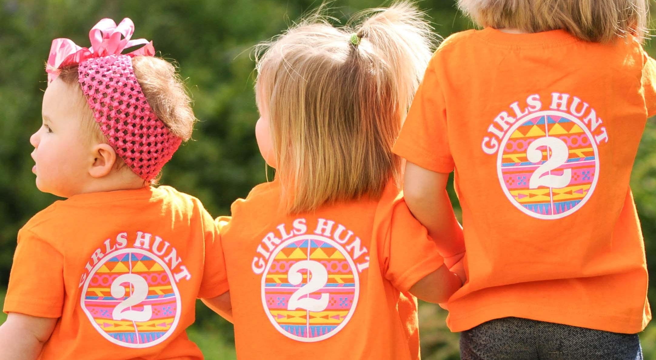Three Young Ladies in Shirts that say _Girls Hunt 2_ on the Back